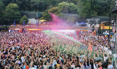 dj boy: ISTANBUL, TURKEY - AUGUST 01, 2015: Colored water gushing from stage in Life in Color the Big Bang tour in Istanbul Kurucesme Arena Editorial