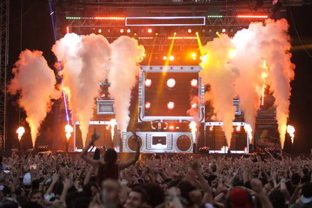 ISTANBUL, TURKEY - AUGUST 01, 2015: DJ Ummet Ozcan on stage of Life in Color the Big Bang tour in Istanbul Kurucesme Arena
