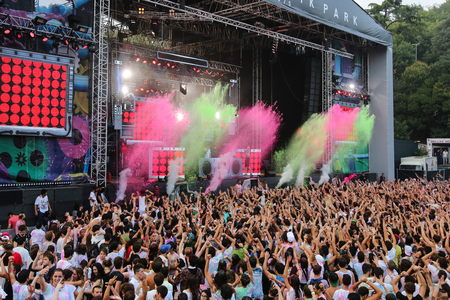 concert crowd: ISTANBUL, TURKEY - AUGUST 01, 2015: Colored water gushing from stage in Life in Color the Big Bang tour in Istanbul Kurucesme Arena Editorial
