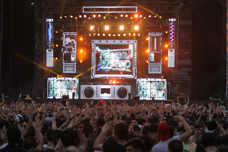 concert stage: ISTANBUL, TURKEY - AUGUST 01, 2015: DJ Ummet Ozcan on stage of Life in Color the Big Bang tour in Istanbul Kurucesme Arena