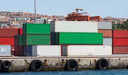 dockside: Containers waiting to transfer in a port Stock Photo