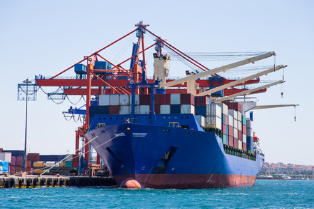 goods: Container Ship is loading in a port