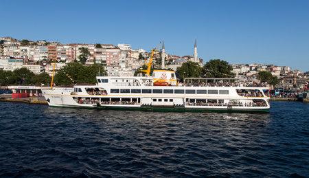 seaway: ISTANBUL, TURKEY - JULY 18, 2015: Sehir Hatlari ferry in Uskudar Port. Sehir Hatlari was established in 1844 and now carry 150,000 passengers a day. Editorial