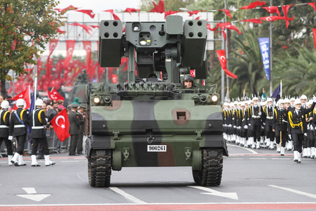 29: ISTANBUL, TURKEY - OCTOBER 29, 2015: Armoured Personnel Carrier with gun in Vatan Avenue during 29 October Republic Day celebration of Turkey