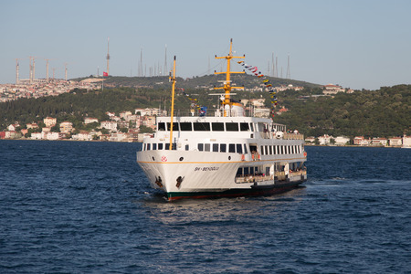 seaway: ISTANBUL, TURKEY - JULY 18, 2015: Sehir Hatlari ferry passing from Asian side to European side of Istanbul. Sehir Hatlari was established in 1844 and now carry 150,000 passengers a day. Editorial
