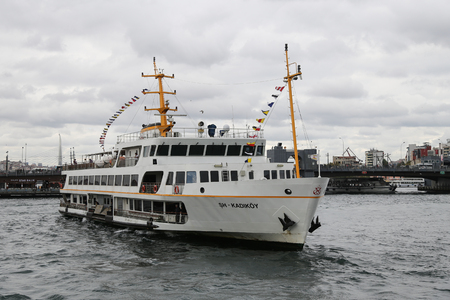 seaway: ISTANBUL, TURKEY - OCTOBER 29, 2015: Sehir Hatlari ferry passing from European side to Asian side of Istanbul. Sehir Hatlari was established in 1844 and now carry 150,000 passengers a day.