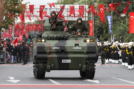 ISTANBUL, TURKEY - OCTOBER 29, 2015: Armoured Personnel Carrier with gun in Vatan Avenue during 29 October Republic Day celebration of Turkey