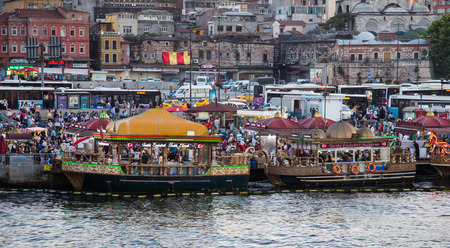 eminonu: ISTANBUL, TURKEY - JULY 17, 2015: Fisher boats in Eminonu District. Eminonu fisher boats are one of the most touristic place in Istanbul. Editorial