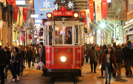 istanbul: ISTANBUL, TURKEY - OCTOBER 29, 2015: Historic red tram on Istiklal Avenue. Red tram is one of the symbol of Istanbul, trams started to work on 1869 in Istanbul.