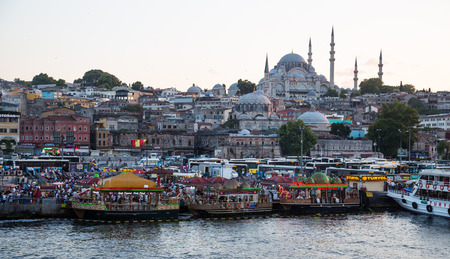 fisher: ISTANBUL, TURKEY - JULY 17, 2015: Fisher boats in Eminonu District. Eminonu fisher boats are one of the most touristic place in Istanbul. Editorial