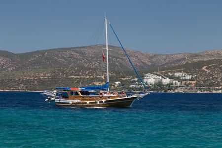 mugla: MUGLA, TURKEY - JULY 16, 2015: People have fun and relaxing in sailboat tour around Bodrum Town,  Aegean sea.
