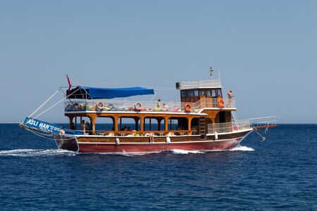 MUGLA, TURKEY - JULY 16, 2015: People have fun and relaxing in boat tour around Bodrum Town,  Aegean sea. Editöryel