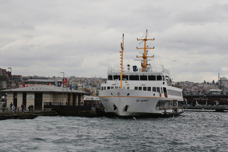 seaway: ISTANBUL, TURKEY - OCTOBER 29, 2015: Sehir Hatlari ferry in Eminonu Port. Sehir Hatlari was established in 1844 and now carry 150,000 passengers a day.