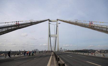 ISTANBUL, TURKEY - NOVEMBER 15, 2015: Bosphorus Bridge after 37th Istanbul Marathon. More than 100000 people attended to marathon, 15K, 10K and fun run. Editorial