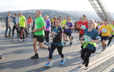 koprusu: ISTANBUL, TURKEY - NOVEMBER 15, 2015: People are crossing the Bosphorus Bridge from Asia to Europe during 37th Istanbul Marathon. More than 100000 people attended to marathon, 15K, 10K and fun run.