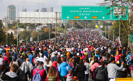 bogazici: ISTANBUL, TURKEY - NOVEMBER 15, 2015: People are crossing the Bosphorus Bridge from Asia to Europe during 37th Istanbul Marathon. More than 100000 people attended to marathon, 15K, 10K and fun run.