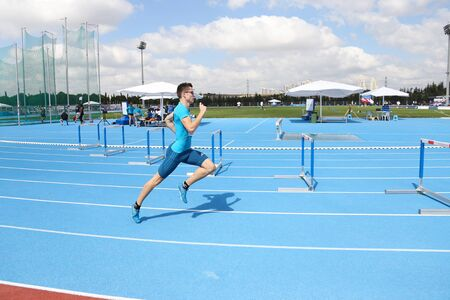 olympic game: ISTANBUL, TURKEY - SEPTEMBER 19, 2015: Athlete Grega Medvesek Running 400m Hurdles during European Champion Clubs Cup Track and Field Juniors Group A Editorial