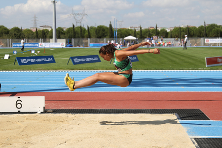 ISTANBUL, TURKEY - SEPTEMBER 19, 2015: Athlete Carmen Ramos long jump during European Champion Clubs Cup Track and Field Juniors Group A