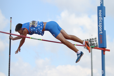jure: ISTANBUL, TURKEY - SEPTEMBER 19, 2015: Athlete Jure Hudoklin pole vaulting during European Champion Clubs Cup Track and Field Juniors Group A