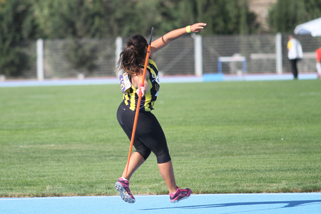 track and field athlete: ISTANBUL, TURKEY - SEPTEMBER 19, 2015: Athlete Eda Tugsuz javelin throwing during European Champion Clubs Cup Track and Field Juniors Group A