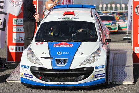 ISTANBUL, TURKEY - NOVEMBER 14, 2015: Yagiz Avci with Peugeot 207 S2000 of Neo Motorspor Team in ceremonial start of Isok Istanbul Rally 2015 Editöryel