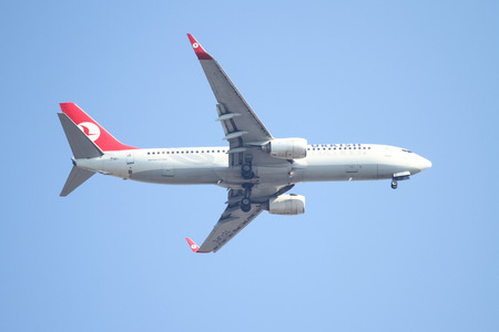 tk: ISTANBUL, TURKEY - JULY 26, 2015: Turkish Airlines Boeing 737-8F2 (CN 2976580) landing to Sabiha Gokcen Airport. THY is the flag carrier of Turkey with 290 fleet size and 276 destinations