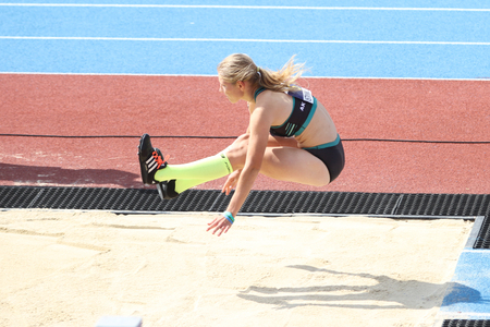 track and field athlete: ISTANBUL, TURKEY - SEPTEMBER 19, 2015: Athlete Barbora Klimova triple jump during European Champion Clubs Cup Track and Field Juniors Group A