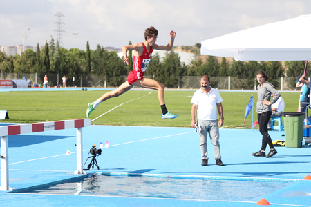 steeplechase: ISTANBUL, TURKEY - SEPTEMBER 19, 2015: Athlete Moreira Jorge Running 3000 metres steeplechase during European Champion Clubs Cup Track and Field Juniors Group A Editorial