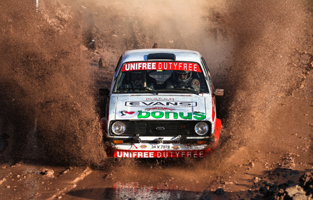 kap: ISTANBUL, TURKEY - NOVEMBER 14, 2015: Engin Kap drives Ford Escord MK2 of Bonus Unifree Parkur Racing Team in Isok Istanbul Rally 2015, Gocbeyli stage