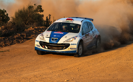 ISTANBUL, TURKEY - NOVEMBER 14, 2015: Yagiz Avci drives Peugeot 207 S2000 of Neo Motorspor Team in Isok Istanbul Rally 2015, Special stage