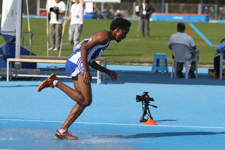 track and field athlete: ISTANBUL, TURKEY - SEPTEMBER 19, 2015: Athlete Abdirahman Ciise Nur Running 3000 metres steeplechase during European Champion Clubs Cup Track and Field Juniors Group A
