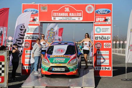 turkiye: ISTANBUL, TURKEY - NOVEMBER 14, 2015: Umit Can Ozdemir with Ford Fiesta R2 of Castrol Ford Team Turkiye in ceremonial start of Isok Istanbul Rally 2015