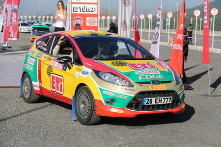 ralli: ISTANBUL, TURKEY - NOVEMBER 14, 2015: Bugra Banaz with Ford Fiesta R2 of Castrol Ford Team Turkiye in ceremonial start of Isok Istanbul Rally 2015 Editorial
