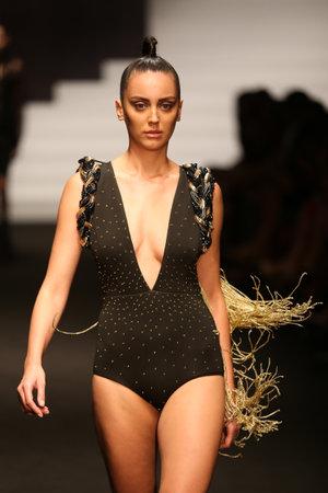 catwalk model: ISTANBUL, TURKEY - SEPTEMBER 30, 2015: A model showcases one of the latest creations in ADL Cengiz Abazoglu Catwalk Editorial