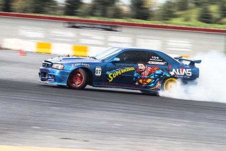 kemal: ISTANBUL, TURKEY - OCTOBER 31, 2015: Kemal Soylu drives R34 Skyline GTRof Alias Racing Team in Apex Masters Turkish Drift Championship. Editorial