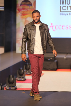 pascal: ISTANBUL, TURKEY - NOVEMBER 07, 2015: Retired French footballer Pascal Olivier Nouma showcase one of the latest creations of Stores in Optimum Outlet during Optimum Fashion days catwalk