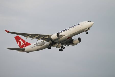 tk: ISTANBUL, TURKEY - NOVEMBER 21, 2015: Turkish Airlines Airbus A330-223 (CN 874) takes off from Istanbul Ataturk Airport. THY is the flag carrier of Turkey with 299 fleet size and 280 destinations