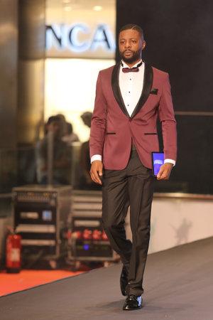 optimum: ISTANBUL, TURKEY - NOVEMBER 07, 2015: RetiredFrenchfootballer Pascal Olivier Nouma showcase one of the latest creations of Stores in Optimum Outlet during Optimum Fashion days catwalk