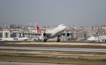 thy: ISTANBUL, TURKEY - NOVEMBER 21, 2015: Turkish Airlines Airbus A330-223 (CN 949) takes off from Istanbul Ataturk Airport. THY is the flag carrier of Turkey with 299 fleet size and 280 destinations