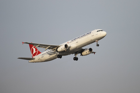tk: ISTANBUL, TURKEY - NOVEMBER 21, 2015: Turkish Airlines Airbus A321-231 (CN 5077) takes off from Istanbul Ataturk Airport. THY is the flag carrier of Turkey with 299 fleet size and 280 destinations