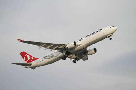 thy: ISTANBUL, TURKEY - NOVEMBER 21, 2015: Turkish Airlines Airbus A330-303 (CN 1499) takes off from Istanbul Ataturk Airport. THY is the flag carrier of Turkey with 299 fleet size and 280 destinations Editorial