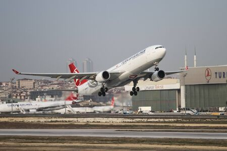 tk: ISTANBUL, TURKEY - NOVEMBER 21, 2015: Turkish Airlines Airbus A330-303 (CN 1499) takes off from Istanbul Ataturk Airport. THY is the flag carrier of Turkey with 299 fleet size and 280 destinations Editorial