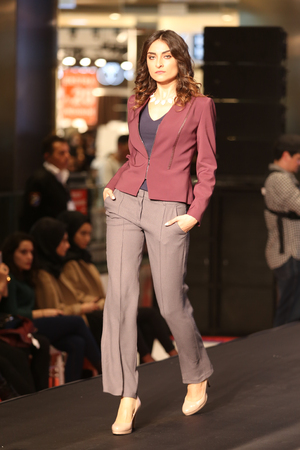 optimum: ISTANBUL, TURKEY - NOVEMBER 07, 2015: A model showcases one of the latest creations of Stores in Optimum Outlet during Optimum Fashion days catwalk Editorial