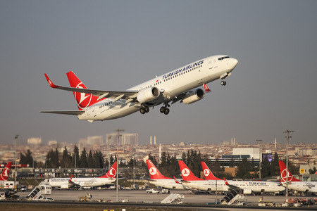thy: ISTANBUL, TURKEY - NOVEMBER 21, 2015: Turkish Airlines Boeing 737-9F2ER (CN 409773948) takes off from Istanbul Ataturk Airport. THY is the flag carrier of Turkey with 299 fleet size and 280 destinations