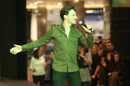 optimum: ISTANBUL, TURKEY - NOVEMBER 07, 2015: Singer Edis performs after Optimum Fashion days catwalk Editorial