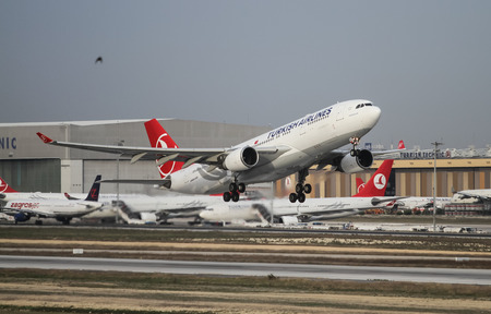 thy: ISTANBUL, TURKEY - NOVEMBER 21, 2015: Turkish Airlines Airbus A330-202 (CN 882) takes off from Istanbul Ataturk Airport. THY is the flag carrier of Turkey with 299 fleet size and 280 destinations