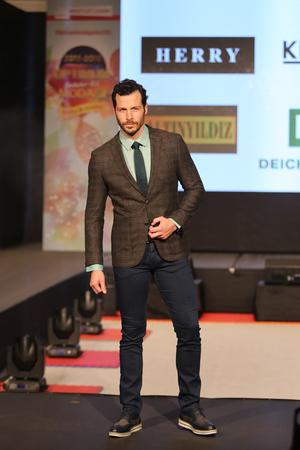 optimum: ISTANBUL, TURKEY - NOVEMBER 07, 2015: Model Carlos Martin showcase one of the latest creations of Stores in Optimum Outlet during Optimum Fashion days catwalk Editorial