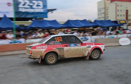 escort: KOCAELI, TURKEY - AUGUST 22, 2015: Burak Turkkan with Ford Escort MK2 of Bonus Unifree Parkur Racing Team in special stage of Kocaeli Rally 2015