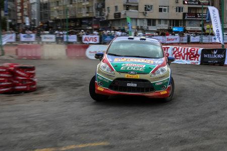 turkiye: KOCAELI, TURKEY - AUGUST 22, 2015: Umit Can Ozdemir with Ford Fiesta R2 of Castrol Ford Team Turkiye in special stage of Kocaeli Rally 2015