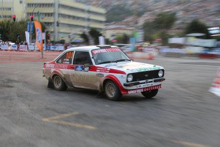 escort: KOCAELI, TURKEY - AUGUST 22, 2015: Engin Kap with Ford Escort MK2 of Bonus Unifree Parkur Racing Team in special stage of Kocaeli Rally 2015 Editorial
